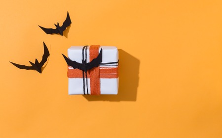 Halloween theme with gift box on a orange background