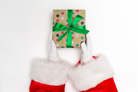 Santa holding a Christmas gift on a white background