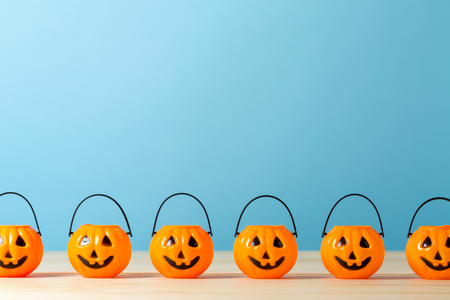 Halloween pumpkins on a table on a blue background