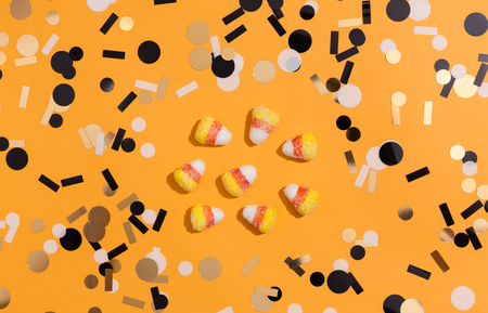 Halloween theme with candies on a orange background 写真素材