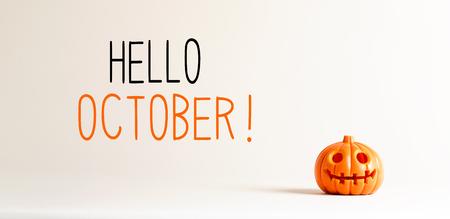 Hello October with small orange pumpkin lantern Stock Photo