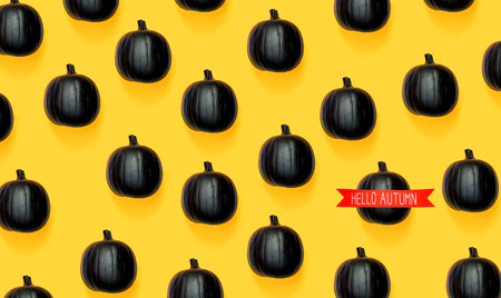 Hello autumn with black colored pumpkin patterns Stock Photo
