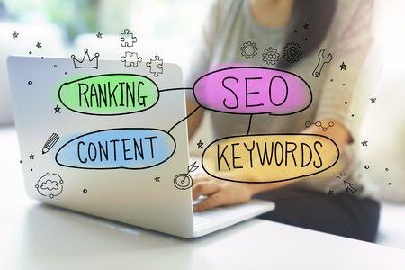 SEO, Ranking, Content and Keywords with woman using her laptop in her home office