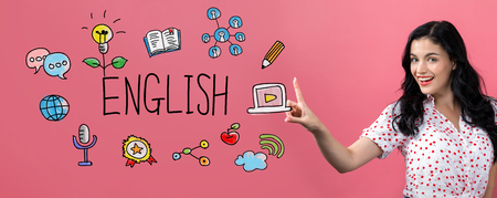 English with young woman on a pink background Stock Photo