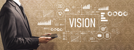 Vision with businessman holding a tablet computer on a dark vintage background