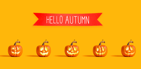 Hello autumn with orange pumpkin lanterns with a red banner