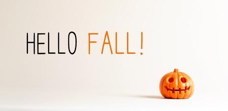 Hello fall with small orange pumpkin lantern