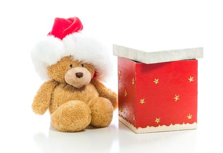 Teddy bear with a Santa hat with a Christmas present box Stock Photo