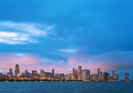 Downtown Chicago cityscape skyline at twilight with Lake Michigan in the foreground