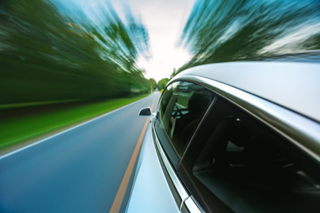 Luxury vehicle driving down the road with motion blur Stock Photo - 109559476