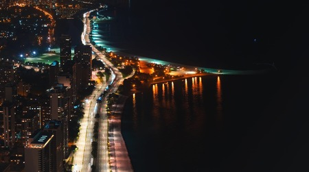 Chicago streets along Lake Michigan from above at night