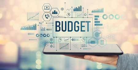Budget with man holding a tablet computer Stockfoto