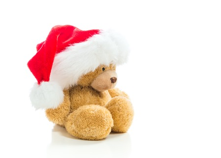 Teddy bear with a Santa hat isolated on white background