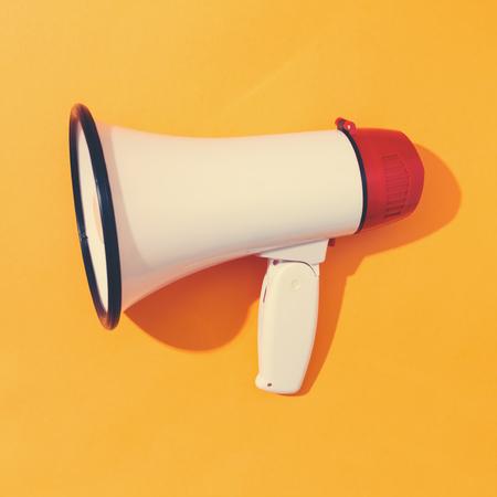 A big megaphone on a orange background