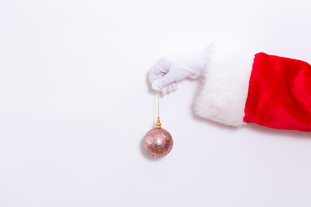Santa claus holding a pink bauble on a white background