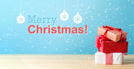 Merry christmas message with Christmas gift boxes with red ribbons Archivio Fotografico