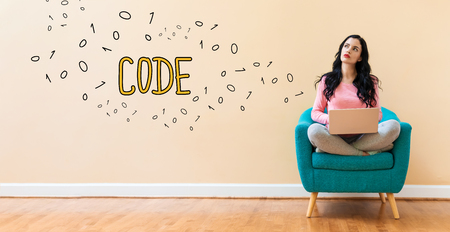 Code with young woman using a laptop computer Stock Photo