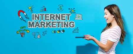 Internet marketing with young woman using her tablet Imagens