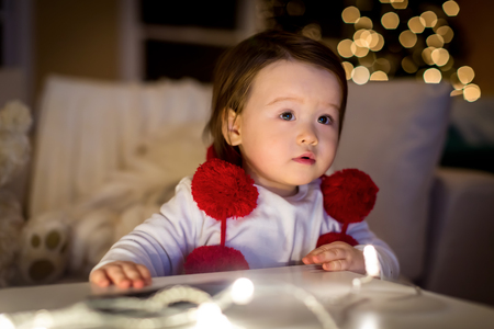 Toddler boy in his house around Christmas time
