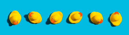 Collection of yellow rubber ducks on a blue background Standard-Bild