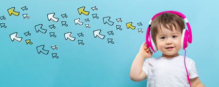 Many small arrows with toddler boy with headphones on a blue background