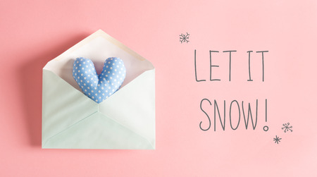 Let It Snow message with a blue heart cushion in an envelope