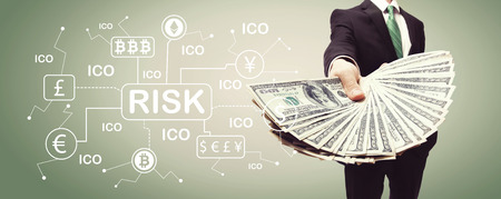 Cryptocurrency risk theme with business man displaying a spread of cash Reklamní fotografie