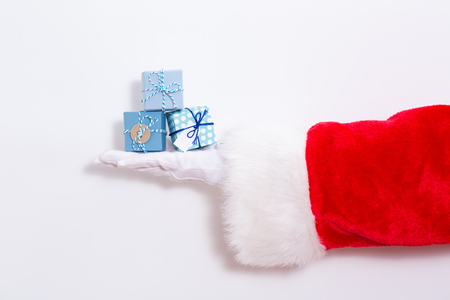 Santa claus holding many gift boxes on a white background Stok Fotoğraf - 109920379