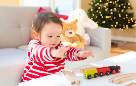 Happy toddler boy playing on Christmas in his house