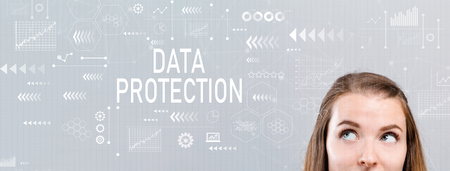 Data protection with young woman looking upwards Stock Photo