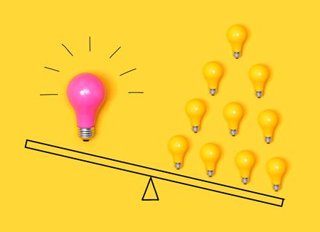 Many ideas versus one big idea with light bulbs Stock Photo