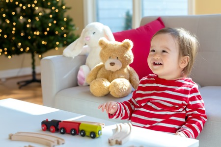 Toddler boy playing in his house around Christmas time Stock Photo