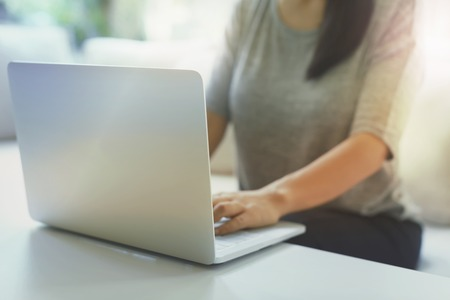 Woman using her laptop in her home office