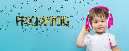 Programming with toddler boy with headphones on a blue background 스톡 콘텐츠 - 110287735