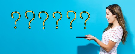 Question marks with young woman using her tablet