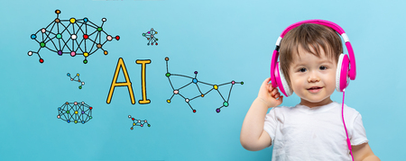 AI theme with toddler boy with headphones on a blue background Stock Photo