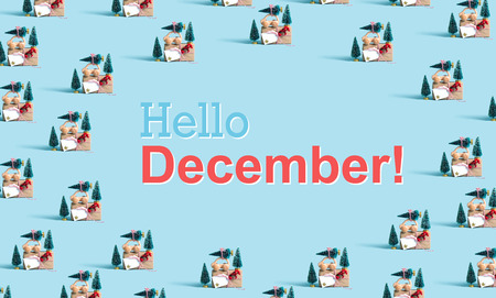Hello December message with little car carrying Christmas trees Stock Photo