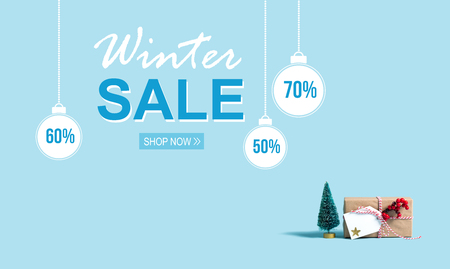 Winter sale message with a Christmas gift box and toy tree