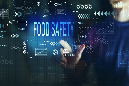 Food safety with young man on a dark background Stock Photo