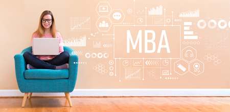 MBA with young woman using her laptop in a chair