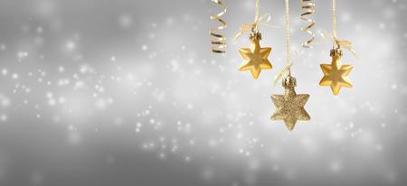 Christmas star ornaments on a shiny light background