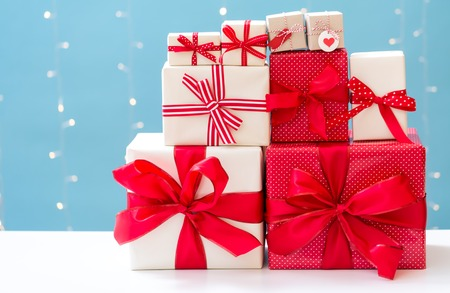 Christmas gift boxes on a shiny light blue background