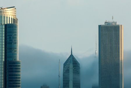 Chicago skyline skyscrapers surrounded by fog at twilight