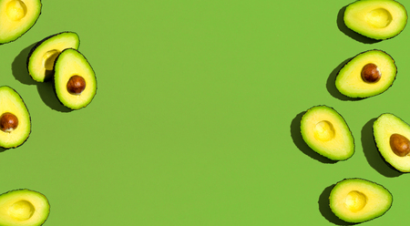 Fresh avocado pattern on a green background flat lay Stock fotó