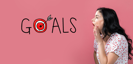 Goals with target with young woman speaking on a pink background