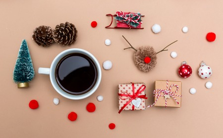 Christmas ornaments with coffee cup on a light brown paper background Stock Photo