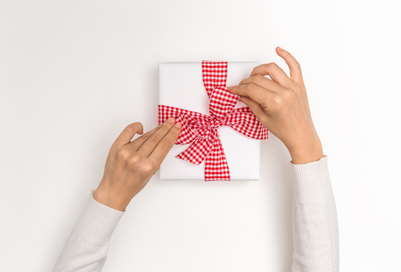 Making a Christmas gift box on a white background
