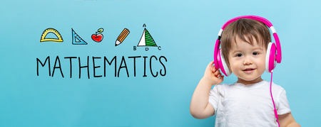 Mathmatics with toddler boy with headphones on a blue background