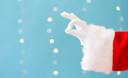 Santa with okay gesture on a shiny light blue background Stock fotó