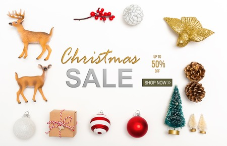 Christmas sale message with small Christmas ornaments on a white background